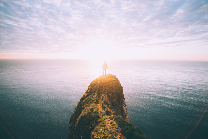 man looking at the sunset and splendid view on the sea to illustrate how to cope with social anxiety